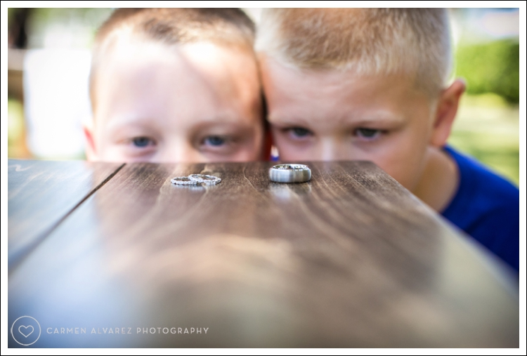 Photo of ring bearers looking at the couple's rings at B.R. Cohn Winery Wedding