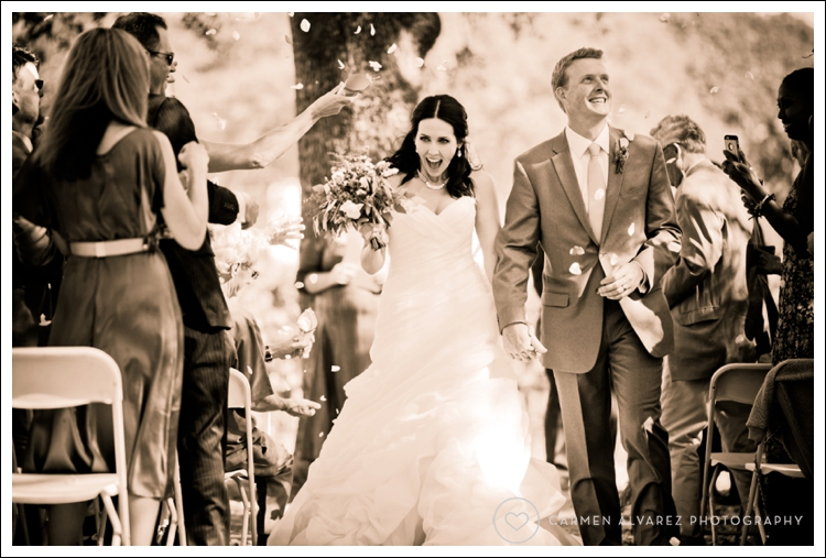 Wedding photo of Lindsey and Scot exiting their ceremony at B.R. Cohn Winery in Sonoma